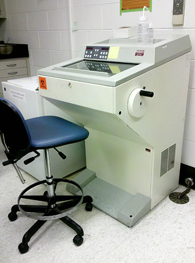 This is a cryostat, an instrument used to make thin slices (sections) of frozen tissue samples.